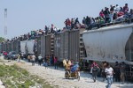 "Migrants heading to the United States often ride atop ""The Beast"", a notorious cargo train that runs through Mexico.  /Keith Dannemiller/International Organization for Migration"