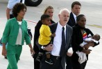 Meriam Yahya Ibrahim of Sudan carries one of her children, as she arrives at Ciampino airport in Rome on July 24 with Lapo Pistelli, Italy's vice minister for foreign affairs, holding her other child, Italian Prime Minister Matteo Renzi, right, and his wife Agnese, left, and Foreign Affairs minister Ferica Mogherini.  /Remo Casilli/Reuters