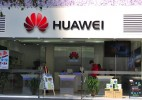 Huawei says reports of NSA spying will not impact growth