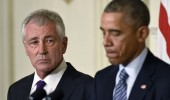 Defense Secretary Chuck Hagel, left, resigns at the White House yesterday. / AP