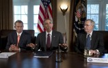 President Barack Obama, flanked by House Speaker John Boehner of Ohio, left, and Senate Majority Leader Mitch McConnell of Ky., speaks to media before his meetin with bipartisan, bicameral leadership of Congress to discuss a wide range of issues, Tuesday, Jan. 13, 2015, in the Cabinet Room of the White House in Washington. (AP Photo/Carolyn Kaster)