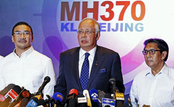 Malaysian Prime Minister Najib Abdul Razak, center, with two senior officials at a March 15 press conference. EPA