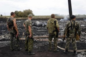 Pro-Russia separatists at the MH17 crash site.  /Reuters