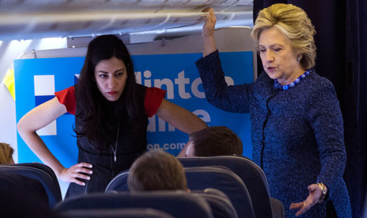 Huma Abedin, left, and Hillary Clinton.